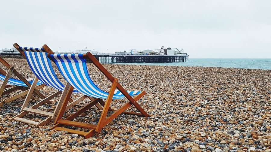 Brighton Beach Deck Chair Seafront Peaceful Sea Beach Sand Summer Sky Horizon Over Water Pier