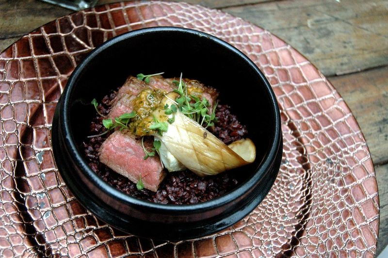 Close-up of food served in bowl on patterned plate