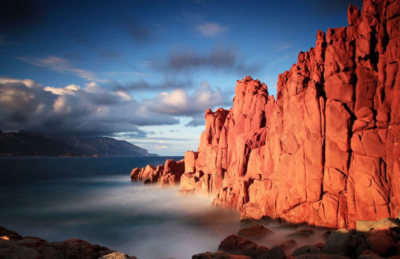 Arbatax Red Rocks  Tortoli Ogliastra Sardegna Sky Water Beauty In Nature Rock Scenics - Nature Cloud - Sky Tranquil Scene Nature Rock - Object Tranquility Idyllic Solid Rock Formation Non-urban Scene Mountain Remote Environment Sunset No People Formation Eroded