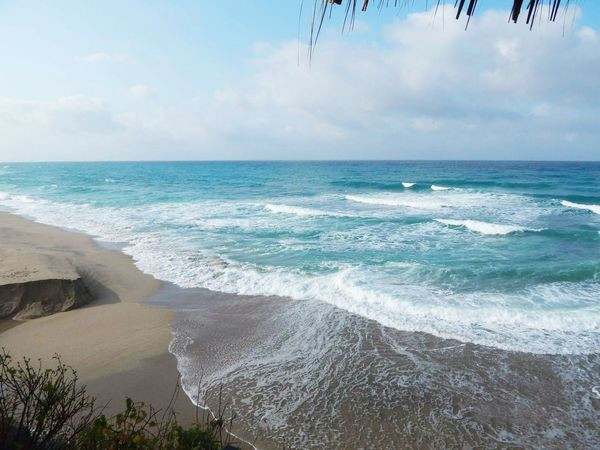 Los Naranjos Beach, Santa Marta, Colombia Sea Beach Travel Destinations Scenics Nature Outdoors Beauty In Nature Vacations Sand Tranquility Water Travelphotography Travel Photography Traveling Travel Colombia Postcard Surf