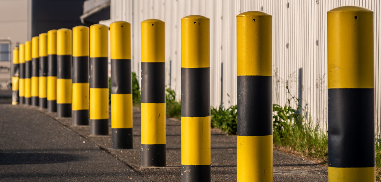 Business Security Architecture Barrier Bitt Bollard Close-up Focus On Foreground Fuel And Power Generation Group In A Row Industry No People Order Outdoors Repetition Secure Street Transportation Yellow