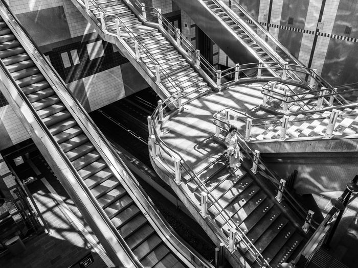 Blaak station in Rotterdam, The Netherlands Rotterdam Stairs Station Absence Architecture Blaak Black And White Built Structure Connection Consumerism Day Directly Above Escalator Escher High Angle View Indoors  Light And Shadow Metal Modern Moving Up No People One Person Railing Space Spiral Staircase Steps And Staircases Technology Train Station