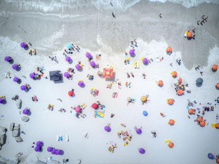 Over Bathers Bathingsuit Beach Multicolored Over Head View Sand & Sea Suntanning Swimsuit Umbrellas