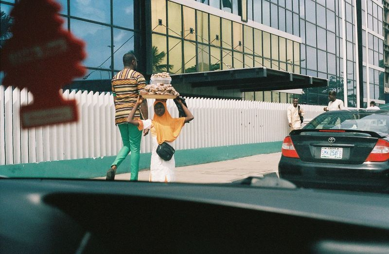 Toy car against window in city
