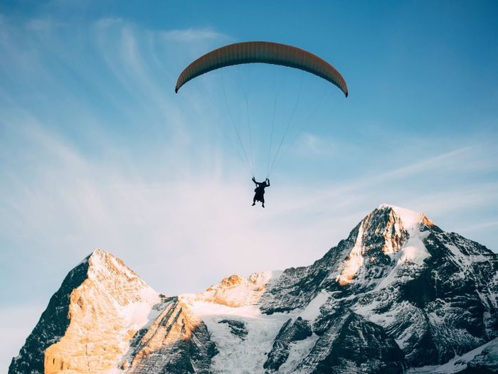 Paragliding Adventure Mountain Extreme Sports One Person Mountain Range Unrecognizable Person Flying Parachute Leisure Activity Real People Exhilaration Beauty In Nature Transportation Nature Full Length Outdoors Low Angle View Sport Day Sky Switzerland VSCO Fresh on Market 2017 Live For The Story Breathing Space