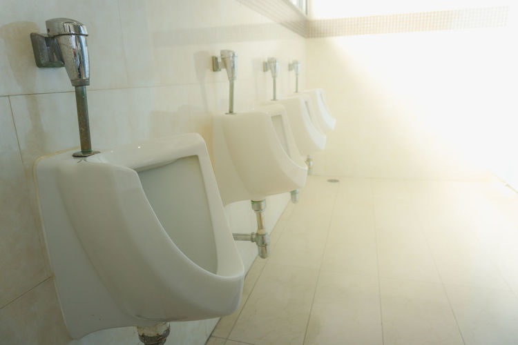 Absence Bathroom Clean Domestic Bathroom Domestic Room Flooring Home Home Interior Household Equipment Hygiene Indoors  Luxury Modern No People Public Building Public Restroom Sunlight Tile Tiled Floor Toilet Wall - Building Feature White Color