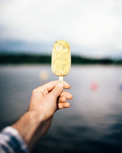 - nICE - EyeEm Selects Human Hand Human Body Part Real People Holding Food And Drink One Person Human Finger Personal Perspective Outdoors Food Water Lake Focus On Foreground Sweet Food Indulgence Leisure Activity Close-up Lifestyles Day Sky Ice Icecream Eisamstiel Summer