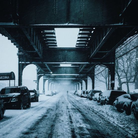 Cars Parked Under Bridge On Winter Day