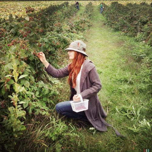 Berry Picking is a yearly activity fot our family. our children have participated in this activity from the time they were attatchedto my breast. this is our beloved daughter-in-law embracing the tradition. The Story Behind The Picture