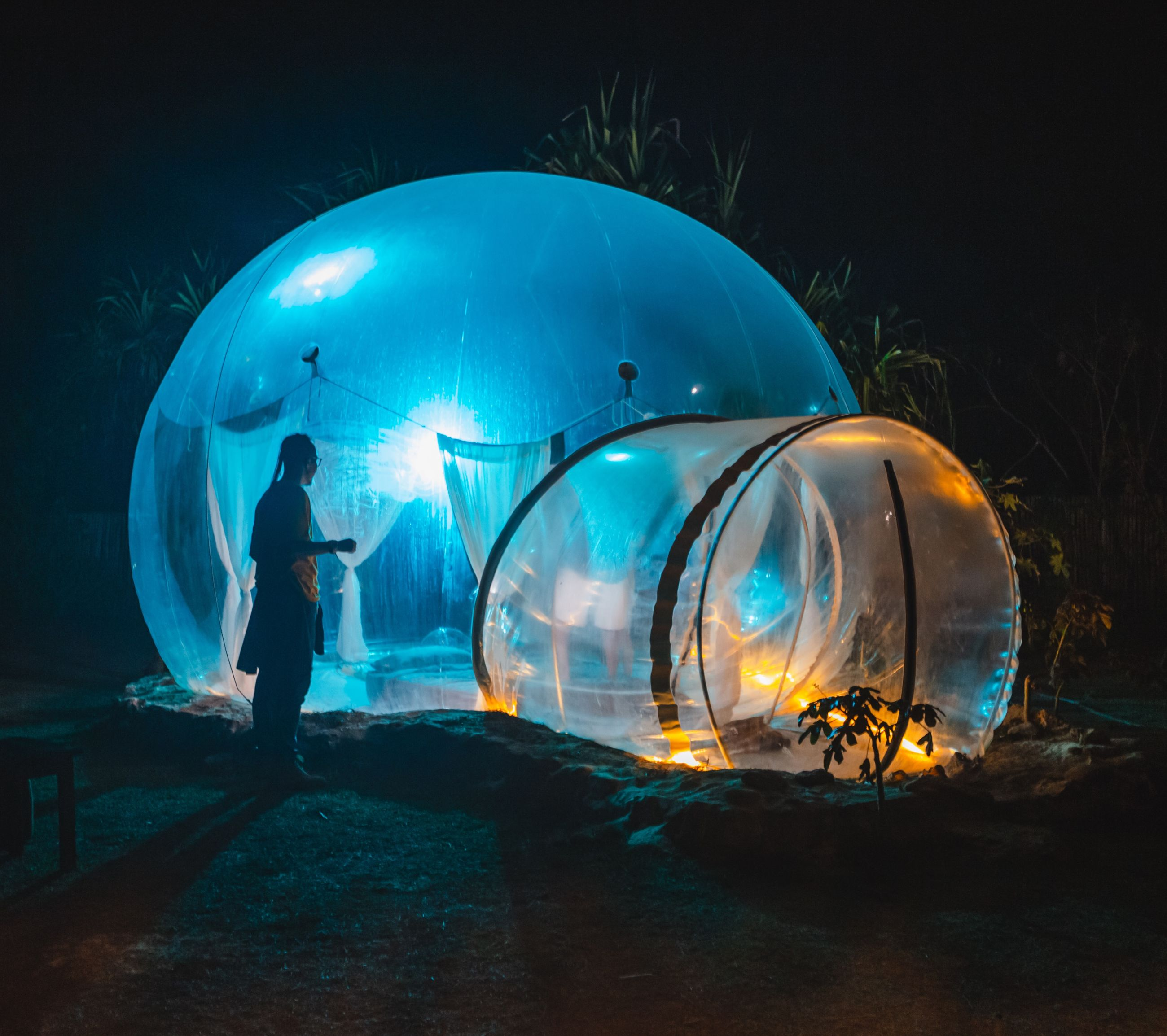 one person, real people, night, full length, illuminated, men, nature, lifestyles, standing, sphere, glowing, leisure activity, outdoors, land, blue, side view, shape, lighting equipment, transparent, digital composite