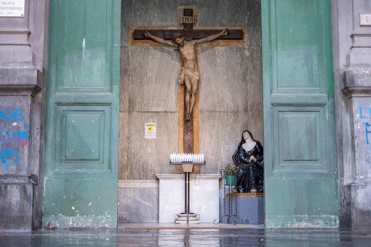 Statue against door of building
