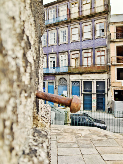Oporto, Portugal Apartment Architecture Building Building Exterior Built Structure City Day Nature Old One Person Outdoors Real People Residential District Selective Focus Street Wall Wall - Building Feature Window