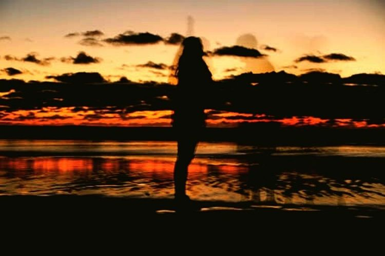 Silhouette Sunset Reflection One Person Nature Tranquility Sky Beauty In Nature People Outdoors Lake Water Scenics Standing Adults Only One Woman Only Tree Night Adult Only Women TheWeekOnEyeEM