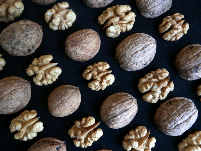 Parallels Diagonals Directly Above Full Frame Food Knolling Large Group Of Objects Things Organized Neatly Abundance Arrangement Order Black Background Walnuts Nuts Patterns Geometric Still Life Organic No People Overhead View Indoors