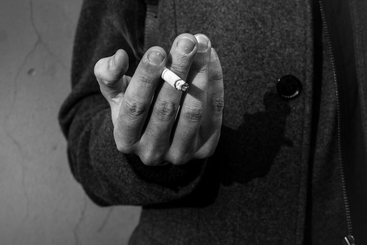 Close-Up Midsection Of Man Smoking Cigarette