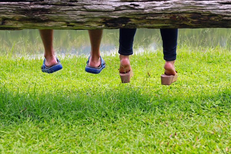 Low section of people standing on grass