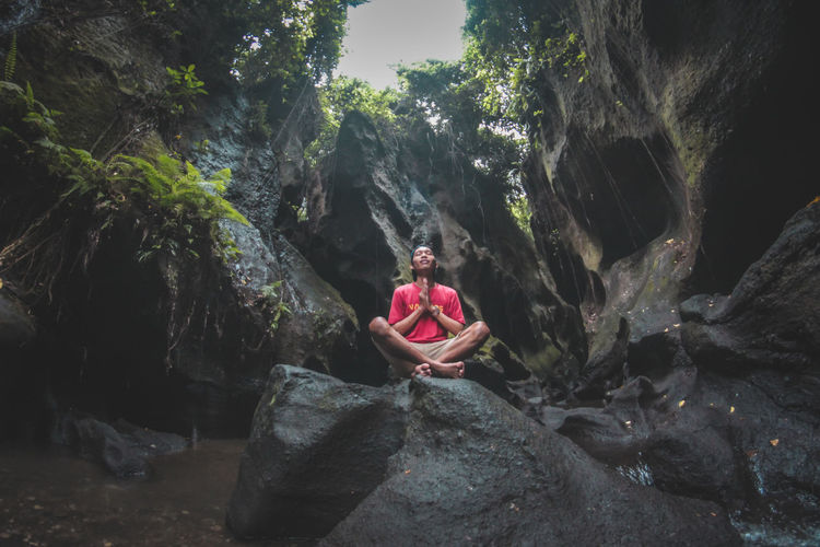 learn to meditate on the Hidden Canyon - Bali Hidden Canyon A New Beginning Adult Bali Island Beauty In Nature Day Flowing Water Full Length Healthy Lifestyle Hiddencanyon Holiday Leisure Activity Lifestyles Nature One Person Outdoors Real People Rock Rock - Object Sitting Solid Trip Young Adult Meditating