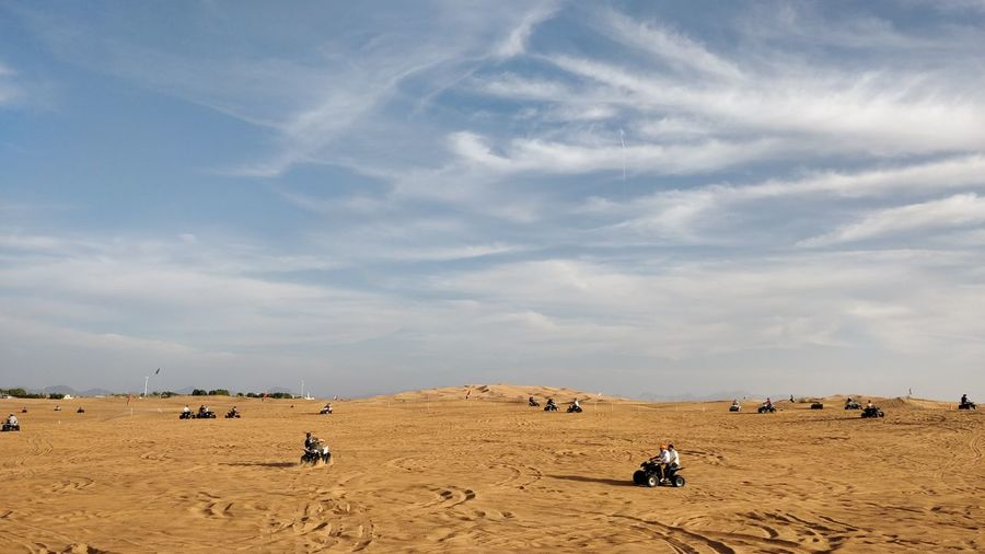 EyeEm Selects Desert Sand Camel Sand Dune Sky Arid Climate Outdoors Nature Landscape Cloud - Sky Day Only Men One Man Only Scenics Animal Themes Adult Beauty In Nature Adults Only Summer People Quad Biking