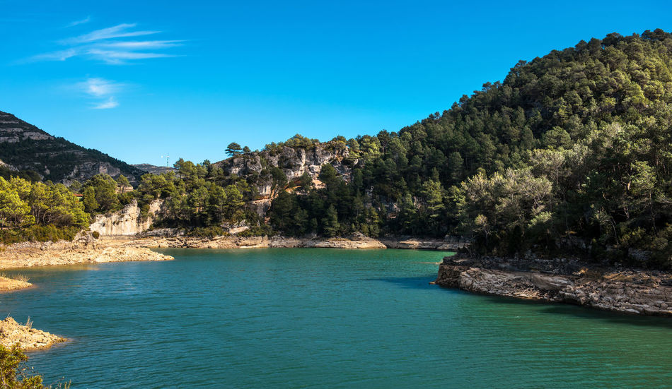 View of the Ulldecona reservoir. Valencian Community, Spain Blue Sky Europe Green Water Lake Landscape Mountain Nature Nobody Outdoors Reservoir Reservoir Dam River Rock Rock Formation Rocky Coast Rocky Mountains Scenery South SPAIN Sunny Day Travel Destinations Turquoise Water Ulldecona Water Waterside