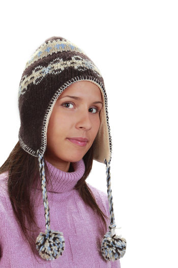 Winter portrait of a woman Fashion Hat Winter Young Close-up Clothes Cut Out Cut Out On White Expression Front View Headshot Necklace One Person Person Portrait Real People Season  Seasonal Studio Shot Wearing White Background Young Adult