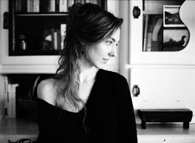 Adult Analog Beautiful Woman Blackandwhite Contemplation Focus On Foreground Front View Hairstyle Headshot Home Interior Indoors  Lifestyles Looking Looking Away Mediumformat One Person Portrait Real People Standing Waist Up Women Young Adult Young Women