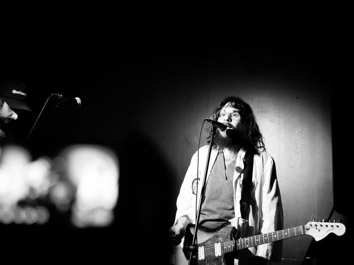 Man standing while playing guitar