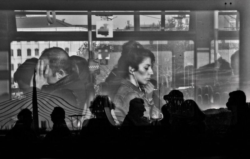 Multiple Exposure Image Of People Sitting At Cafe