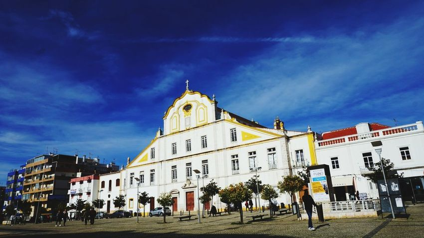Townsquare Favorite Color With Love With Him Sony Sonyalpha Sonya5100 Sonyforher Winter Portugal Alvor Love Architecture Built Structure Sky Building Exterior Travel Destinations Cloud - Sky Large Group Of People Outdoors Day People City