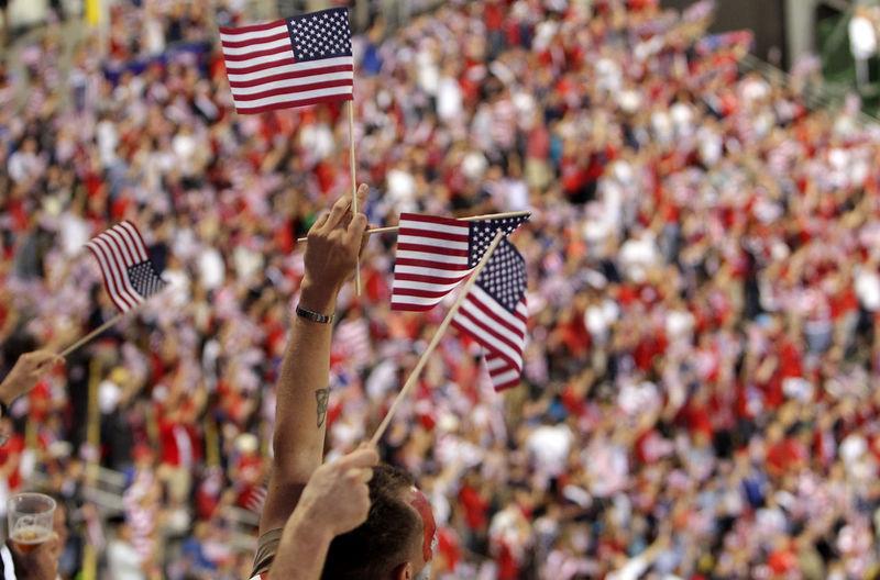 Spectators holding flags in stadium