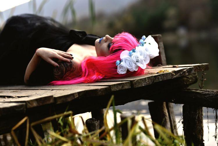 Woman lying on seat