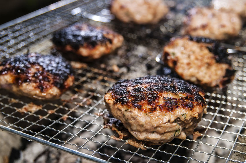 Closeup of burnt pork burger patties on grill Horizontal Pork Barbecue Barbecue Grill Burgers Burnt Close-up Food Freshness Grilled Meat Minced Meat No People Overcooked Patties Patty Ready-to-eat