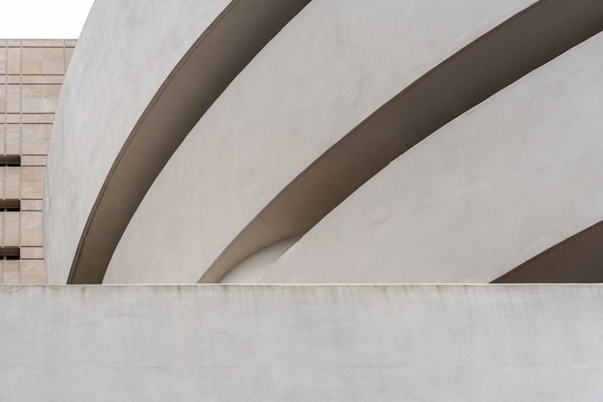 Solomon R. Guggenheim Museum in New York Architecture Day Manhattan NYC NYC Street Photography America American Architecture Solomon R. Guggenheim Museum Museum Frank Lloyd Wright Frank Lloyd Wright Architecture Guggenheim Guggenheimmuseum Guggenheim Nyc Travel Travel Destinations Tourism Tourist Attraction  Built Structure Building Exterior No People Low Angle View Wall - Building Feature Building Outdoors Staircase Pattern Nature White Color Modern Design Sunlight Wall Railing Steps And Staircases Pipe - Tube Concrete
