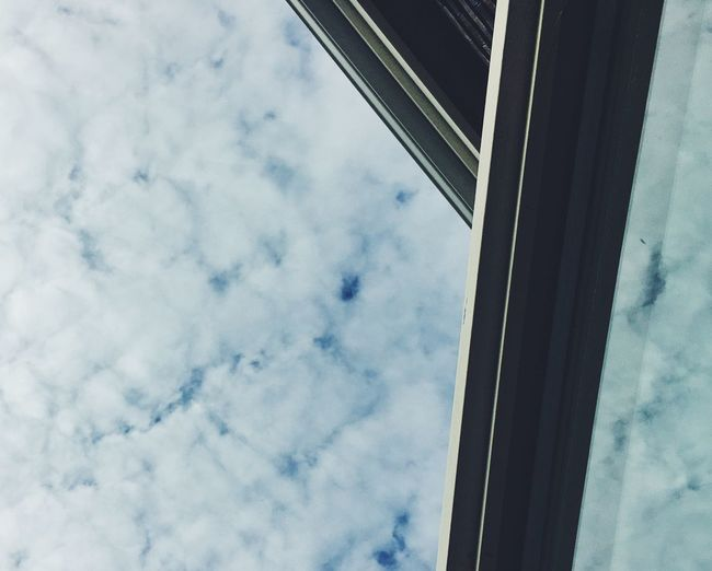 Clouds in reflection Low Angle View Sky Cloud - Sky Architecture Built Structure No People 17.62° Day Nature Building Exterior Outdoors Window Directly Below Glass - Material Blue Reflection