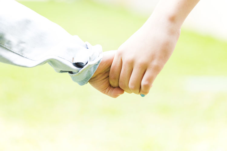 Close-up of hand holding hands