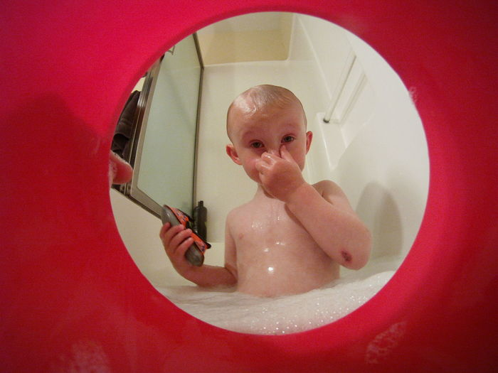 Bath Bath Time Bath Tub Bathtime Bathtoys Bathtub Boy Boyhood Boys Bucket Child Childhood Cute Elementary Age Front View Indoors  Innocence Looking At Camera Looking Out Parenthood Parenting Person Portrait Red Shower