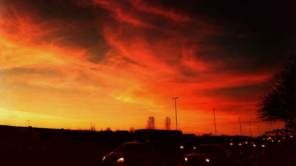 Sunset - in front of my home. Red Sunset Silhouette No People Cloud - Sky Sky First Eyeem Photo Nature HRD Effects Vibrant Color Creativity Cars Transportation The City Light Art Is Everywhere
