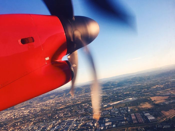 Sky Airplane Air Vehicle City Cityscape Day Colors Red Trip View Sunset Flying Airplane Wing Nature Outdoors One Person Lifestyles Traveling Transportation High Angle View
