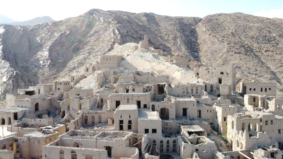 Aerial view of ancient town against mountain