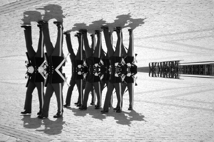 Digital composite image of people walking