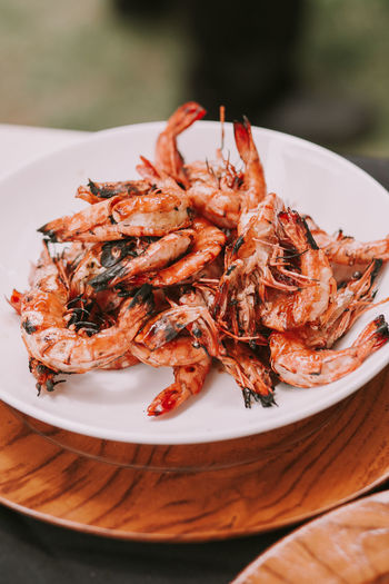 High angle view of prawns in plate on table