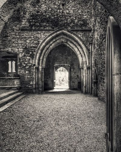 Rock of Cashel Archway Arch Architecture Archway Blackandwhite Building Exterior Built Structure Church Culture Day Diminishing Perspective Door Entrance Historic History Indoors  IPhoneography Ireland Old Photography Place Of Worship Religion Rock Of Cashel Spirituality Stone Wall The Way Forward