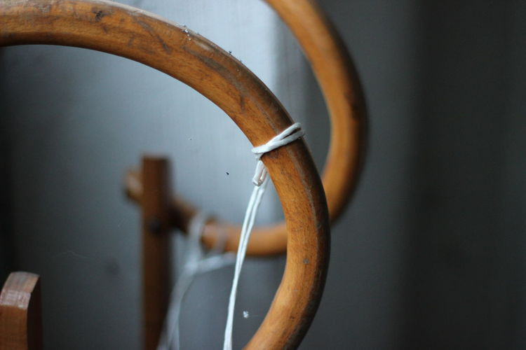 Close-up of string tied on pipe