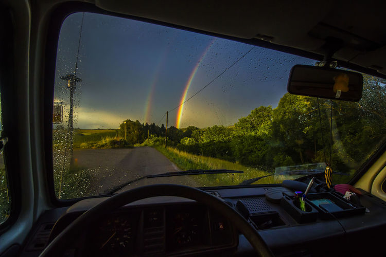 Rainbow Bus ✌ Car Car Interior Windshield Transportation No People Window Water Sky Let's Go. Together. Hippie ✌ Nature Cloud - Sky Freedom T3 Hippielife Happiness Vanlife Outdoors Goodlife❤ Transportation Rear View Naturelovers Rainbow Rainbow Sky Rainbow🌈 Sommergefühle EyeEm Selects