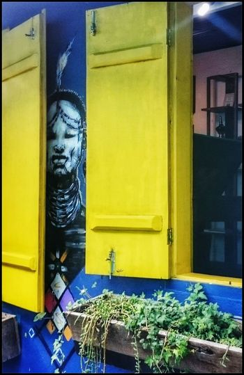 An indian watching behind the yellow window. Indian Hanging Out Taking Photos Check This Out EyeEm Gallery EyeEm Team Eye4photography  Photos Photography Eyeemphotography EyeEm Art Photography Street Art Sony Streetphoto_color Street Photography Streetphotography Artphotography Coloured House Open Window Yellow Yellow Window The Street Photographer - 2016 EyeEm Awards Window Blue Wall