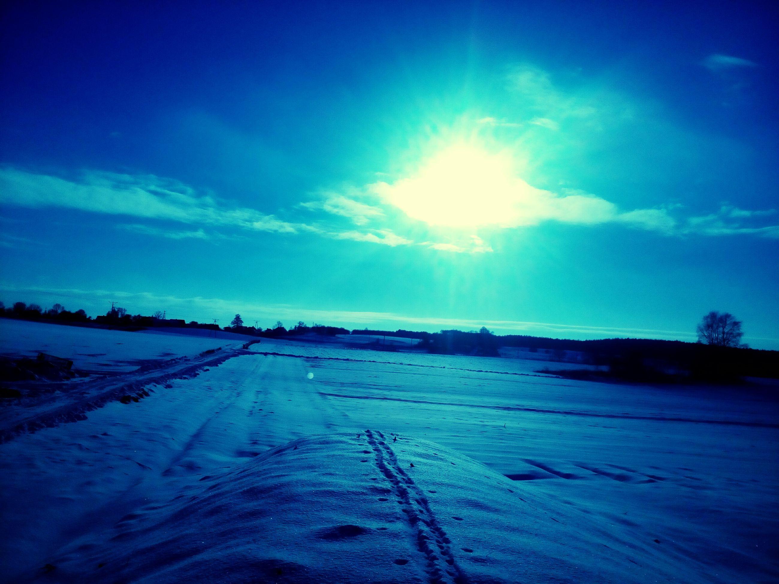 snow, winter, cold temperature, sky, landscape, tranquility, tranquil scene, season, blue, nature, field, sun, beauty in nature, sunlight, weather, scenics, covering, frozen, cloud - sky, sunbeam