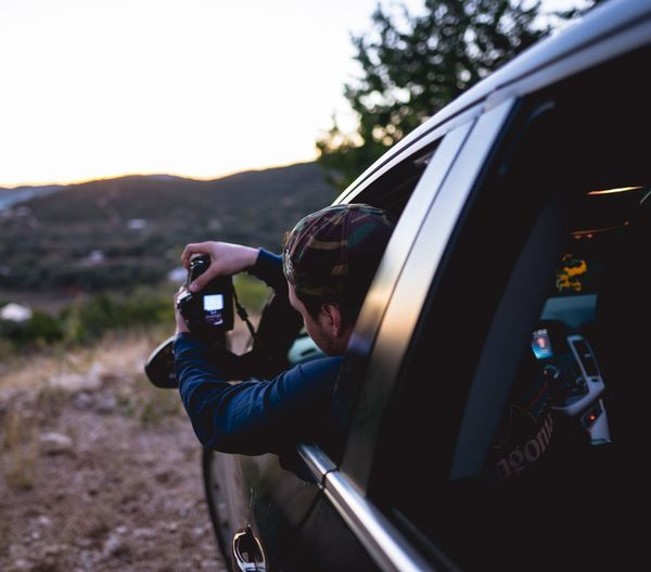 Close-up of person photographing camera