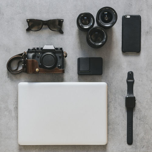 Essentials Essentials Travel Camera Camera - Photographic Equipment Directly Above Flatlay Laptop Lenses No People Photography Themes Smart Watch Sunglasses Technology Watch