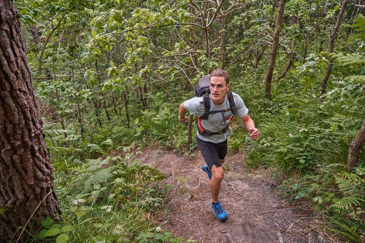 Full length of man running in forest