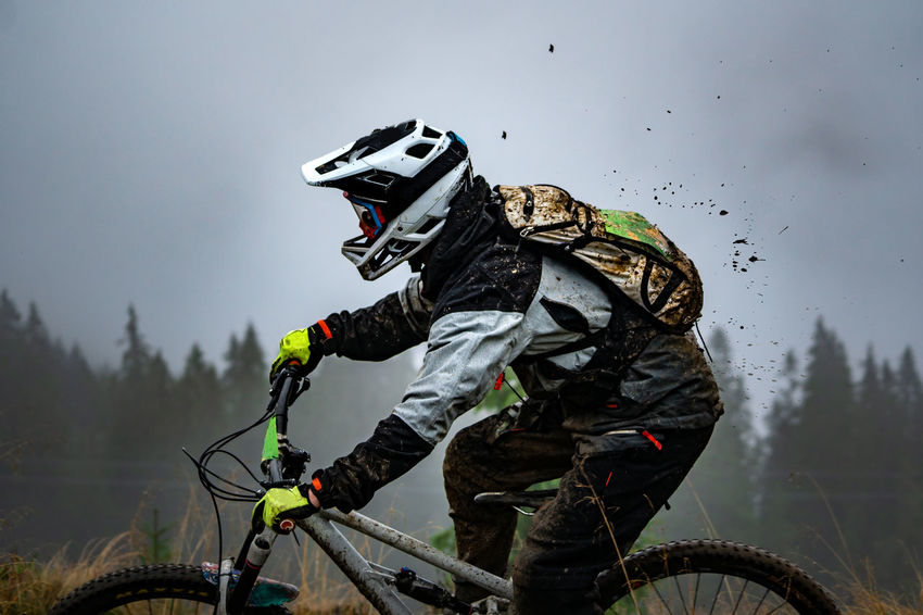Enduro bike rider in the mud Athlete Headwear Motocross Extreme Sports Stunt Sport Sportsman Sports Helmet Adventure Sports Clothing Mountain Bike Cycling Helmet Racing Bicycle Pedal Uphill Cycling Biker Riot Crash Helmet Bmx Cycling Protective Sportswear Bicycle