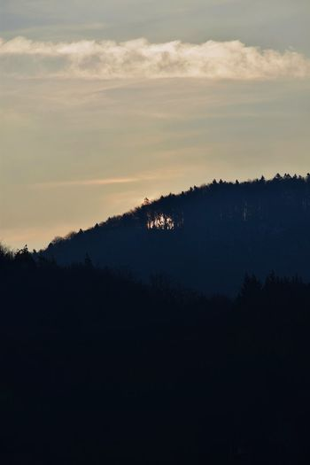Sunrise behind the mountains Affinity Photo Sunrise Nature Tranquility Tree Beauty In Nature Tranquil Scene Landscape Scenics No People Silhouette Sky Outdoors Forest Hazy